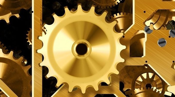 The inner workings of machine, with golden cogs.