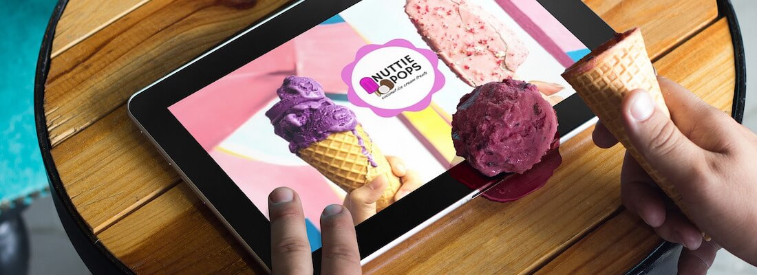 A tablet covered in ice cream.
