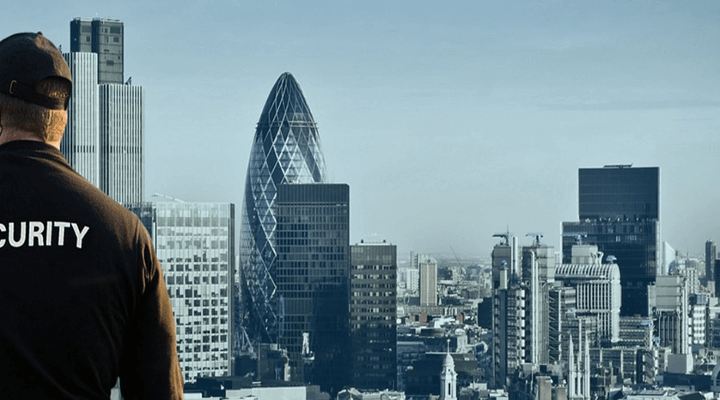 A security officer overlooking a city.