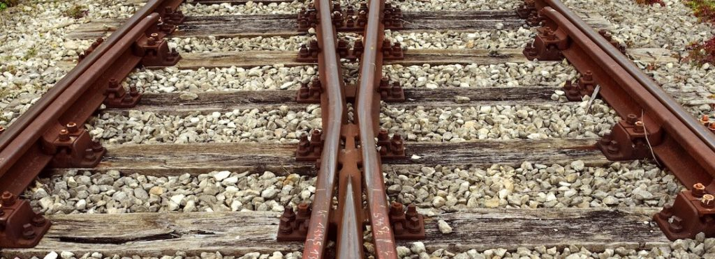 A pair of intertwining train tracks.