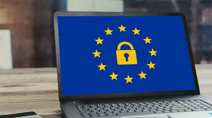 A laptop showing the EU flag with a padlock inside.