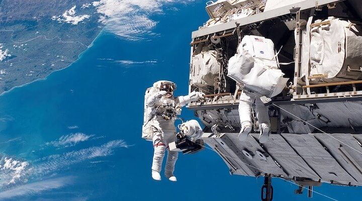An astronaut, untethered from their shuttle.