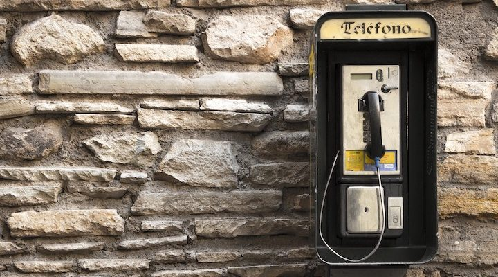 A telephone against a wall.