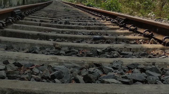 A wonky set of train tracks running off into the distance.