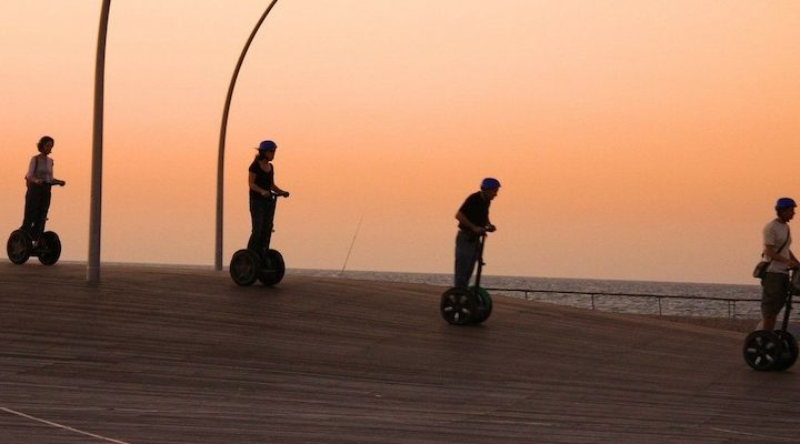 A group of people on Segways.