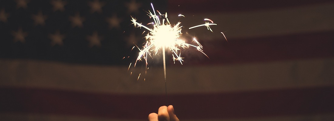 A person holding a sparkler.