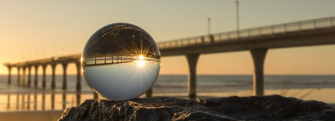 A crystal ball showing an upside down pier.