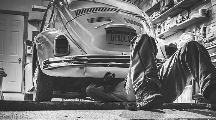 A mechanic working on a car.