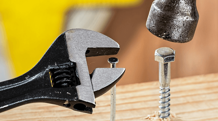 A wrench, a hammer, and a nail.