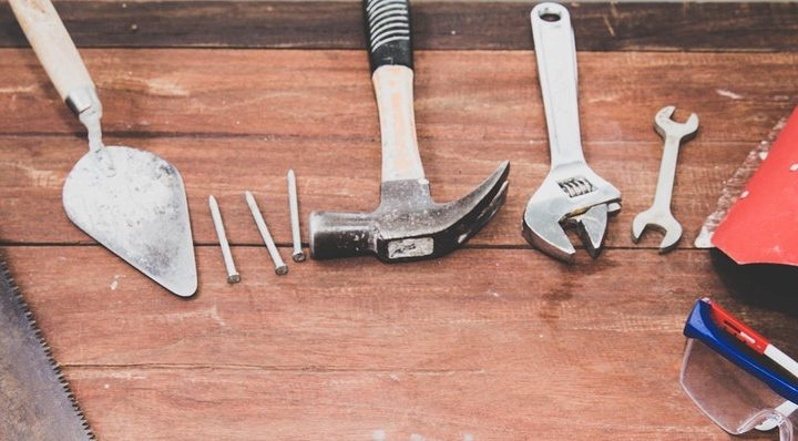 Tools laying on a work bench.