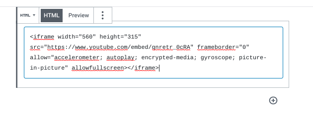 The iframe embed code for a YouTube video pasted in a Custom HTML block.